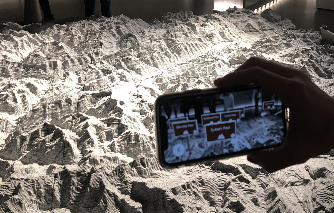 A granite model of the Alps with augmented reality at the Landesmuseum with a ultra realistic statue of modern Helvetia